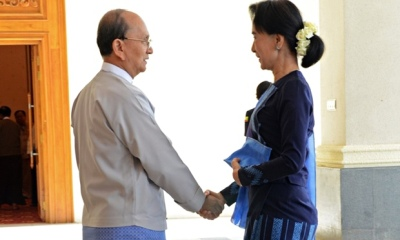 President Thein Sein shakes hands with Aung San Suu Kyi before their two-hour meeting